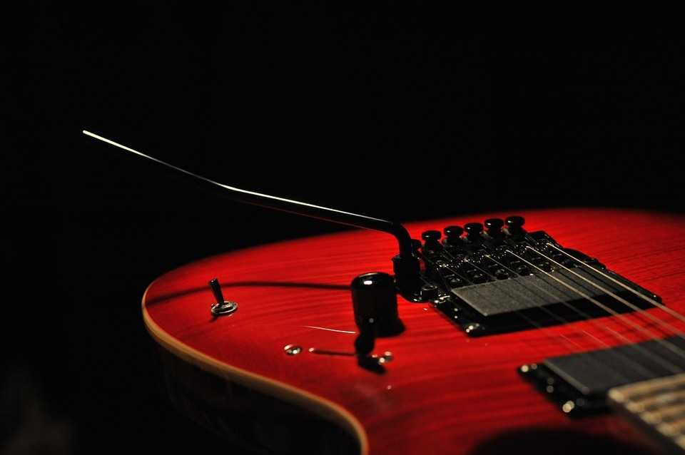 How to play songs on electric guitar